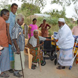 Wheel chair distrubution to crippled, aged leprosy women
