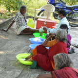 Mobile ulcer care-Soaking of legs with ulcer in medicine water & dressing of leprosy ulcer in camp
